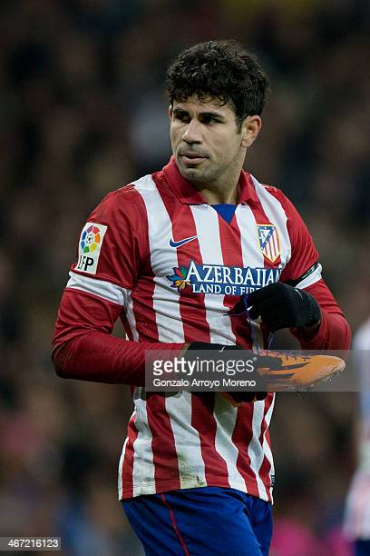 Diego Costa of Atletico de Madrid fits his shoe«s cord during the Copa del Rey semifinal first leg match between Real Madrid CF and Club Atletico...