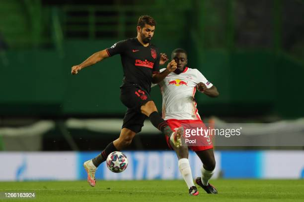 Diego Costa of Atletico de Madrid is challenged by Dayot Upamecano of RB Leipzig during the UEFA Champions League Quarter Final match between RB...