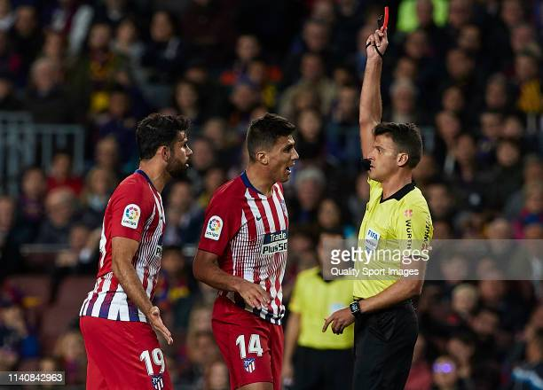 Diego Costa of Atletico de Madrid is shown a red card by referee Jesus Gil Manzano during the La Liga match between FC Barcelona and Club Atletico de...