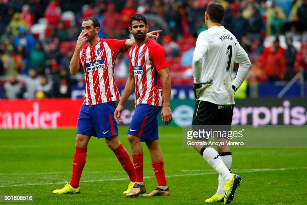 Diego Costa of Atletico de Madrid leaves the pitch ahead his teammate Diego Godin during the La Liga match between Club Atletico Madrid and Getafe CF...