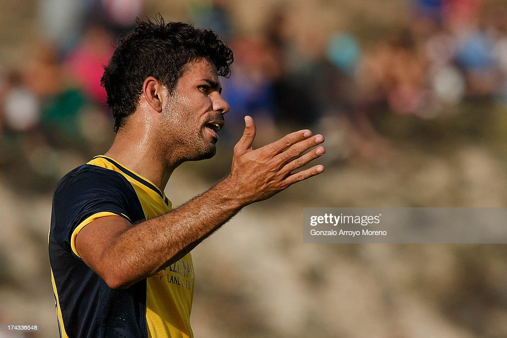 Diego Costa of Atletico de Madrid reacts adter a fault during the Jesus Gil y Gil Trophy between Club Atletico de Madrid and Numancia C. D. at Sporting Club Uxama on July 21, 2013 in Burgo de Osma, Soria, Spain.