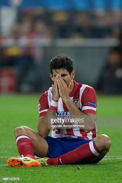 Diego Costa of Atletico de Madrid reacts as he fail to score sitted on the ground during the UEFA Champions League Semi Final first leg match between...