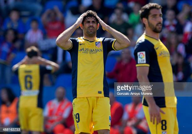 Diego Costa of Atletico de Madrid reacts as his teammate Raul Garcia fails to score during the La Liga match between Levante UD and Club Atletico de...