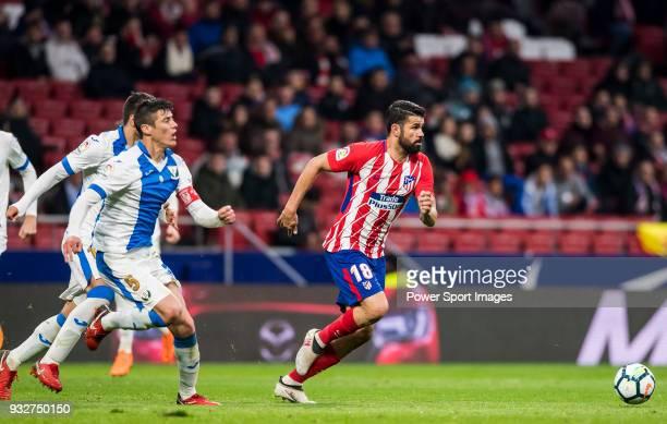 Diego Costa of Atletico de Madrid runs past Martin Maximiliano Mantovani of CD Leganes during the La Liga 201718 match between Atletico de Madrid and...