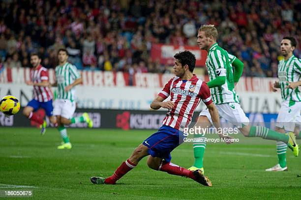 Diego Costa of Atletico de Madrid scores his team's fourth goal during the La Liga match between Club Atletico de Madrid and Real Betis Balompieat at...