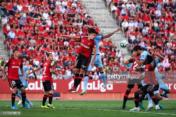 Diego Costa of Atletico de Madrid scores the opening goal with a header during the La Liga match between RCD Mallorca and Club Atletico de Madrid at...