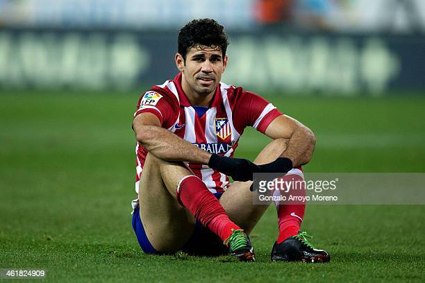 Diego Costa of Atletico de Madrid sits on the ground after failing to score during the La Liga match between Club Atletico de Madrid and FC Barcelona...