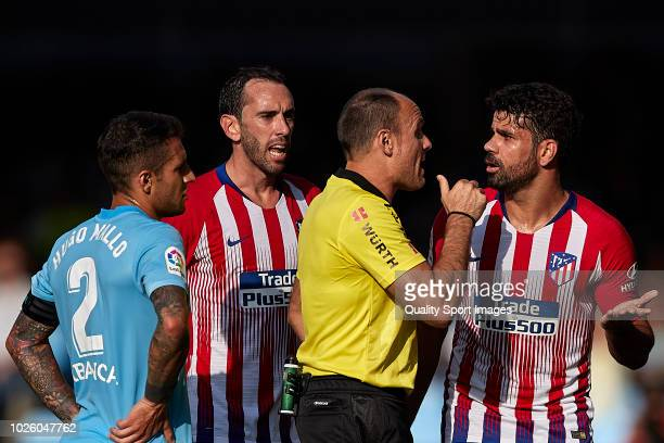 Diego Costa of Atletico de Madrid talks with Referee Antonio Mateu Lahoz during the La Liga match between RC Celta de Vigo and Club Atletico de...