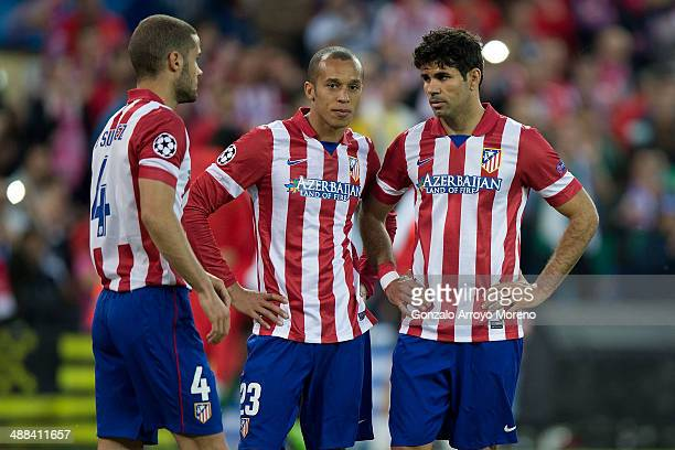 Diego Costa of Atletico de Madrid with his teammates Joao Miranda and Mario Suarez during the UEFA Champions League Semi Final first leg match...