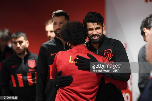 Diego Costa of Atletico greets Mohamed Salah of Liverpool before the UEFA Champions League round of 16 second leg match between Liverpool FC and...