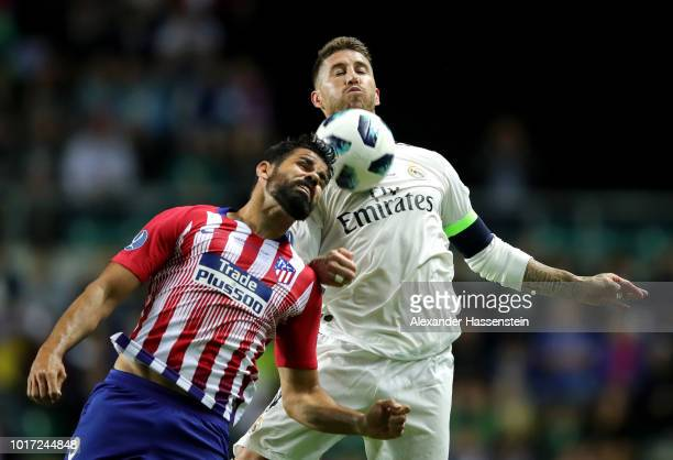 Diego Costa of Atletico Madrid and Sergio Ramos of Real Madrid compete for the ball during the UEFA Super Cup between Real Madrid and Atletico Madrid...