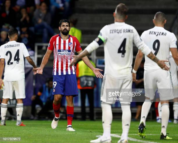 Diego Costa of Atletico Madrid and Sergio Ramos of Real Madrid react during the UEFA Super Cup match between Real Madrid and Atletico Madrid at...