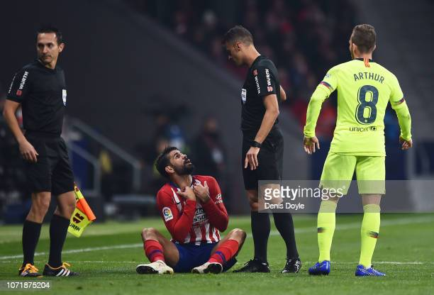 Diego Costa of Atletico Madrid appeals to referee Jesus Gil Manzano intervene during the La Liga match between Club Atletico de Madrid and FC...