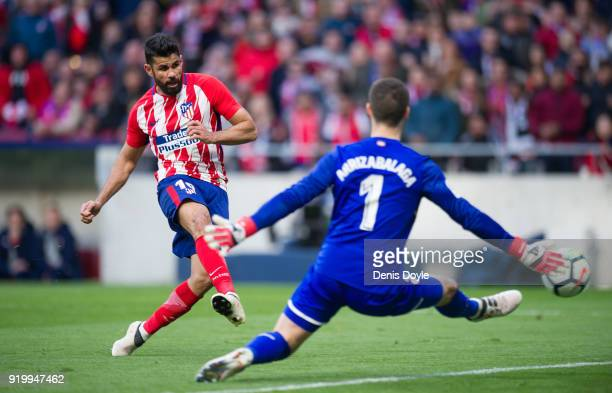 Diego Costa of Atletico Madrid beats Kepa Arrizabalaga of Athletic Club to score his team's 2nd goal during the La Liga match between Atletico Madrid...