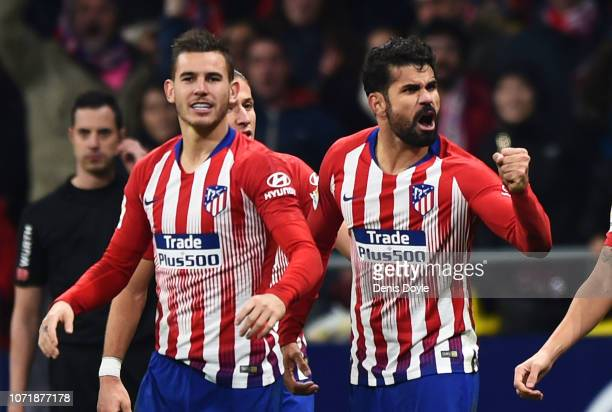 Diego Costa of Atletico Madrid celebrates as he scores his team's first goal wit hteam mates during the La Liga match between Club Atletico de Madrid...