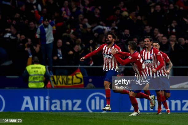 Diego Costa of Atletico Madrid celebrates goal with teammates during the week 13 of La Liga match between Atletico Madrid and FC Barcelona at Wanda...