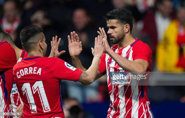 Diego Costa of Atletico Madrid celebrates with Angel Correa after scoring his team's opening goal during the Copa del Rey Quarter Final First Leg...