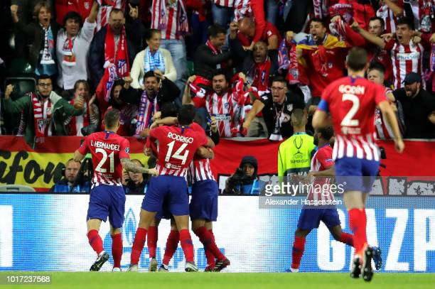 Diego Costa of Atletico Madrid celebrates with teammates after scoring his team's first goal during the UEFA Super Cup between Real Madrid and...