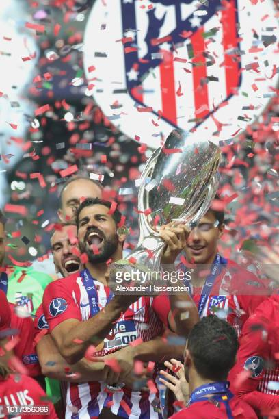 Diego Costa of Atletico Madrid celebrates with the trophy following the UEFA Super Cup between Real Madrid and Atletico Madrid at Lillekula Stadium...