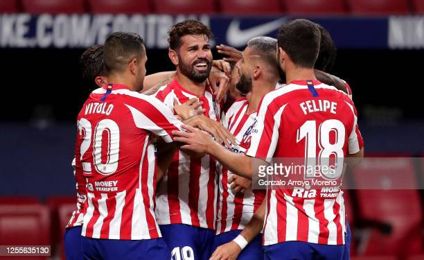 Diego Costa of Atletico Madrid celebrates with Yannick Carrasco Vitolo and Felipe of Atletico Madrid after scoring his team's first goal during the...