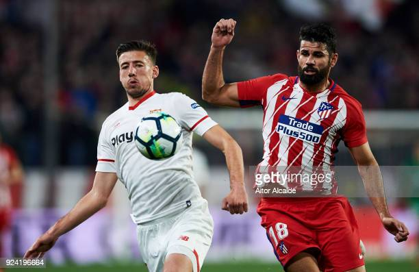 Diego Costa of Atletico Madrid competes for the ball with Clement Lenglet of Sevilla CF during the La Liga match between Sevilla CF and Atletico...