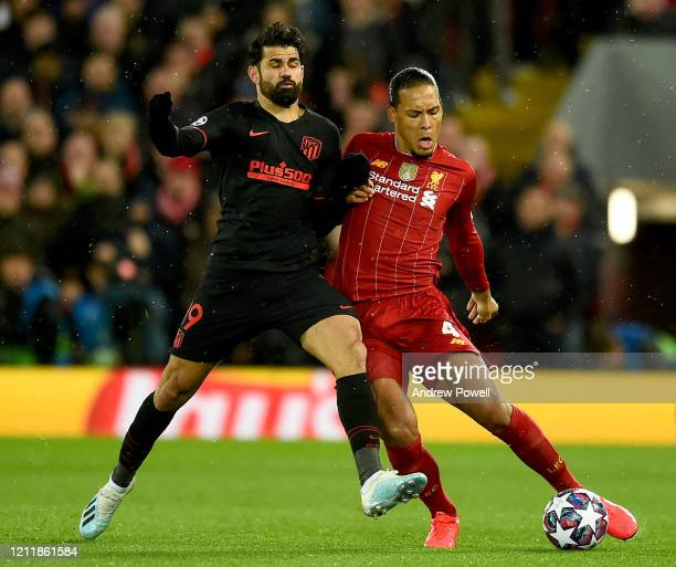 Diego Costa of Atletico Madrid competing with Virgil van Dijk of Liverpool during the UEFA Champions League round of 16 second leg match between...