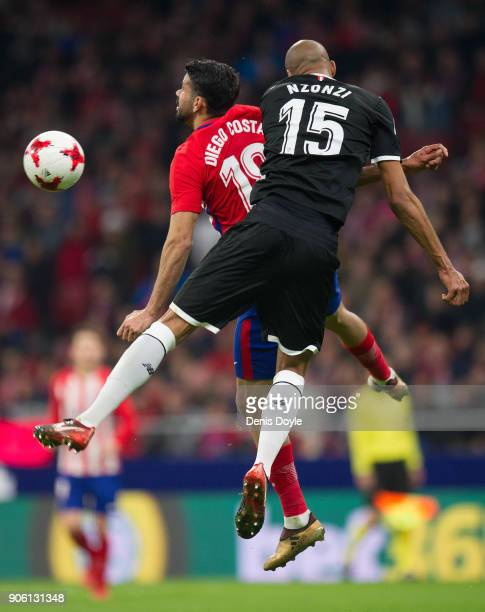 Diego Costa of Atletico Madrid heads the ball beside Steven N'Zonzi of Sevilla during the Copa del Rey Quarter Final First Leg match between Atletico...