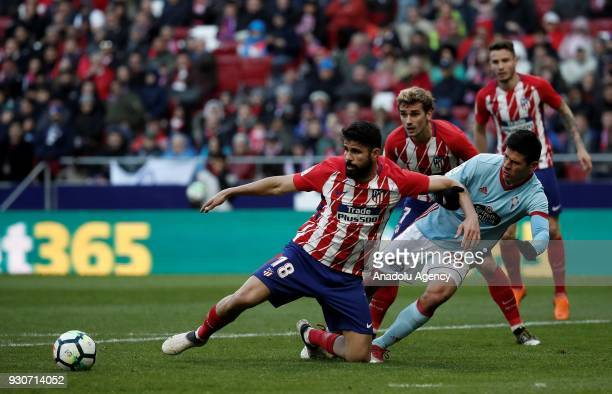 Diego Costa of Atletico Madrid in action against Facundo Roncaglia of Celta Vigo during the La Liga soccer match between Atletico Madrid and Celta...