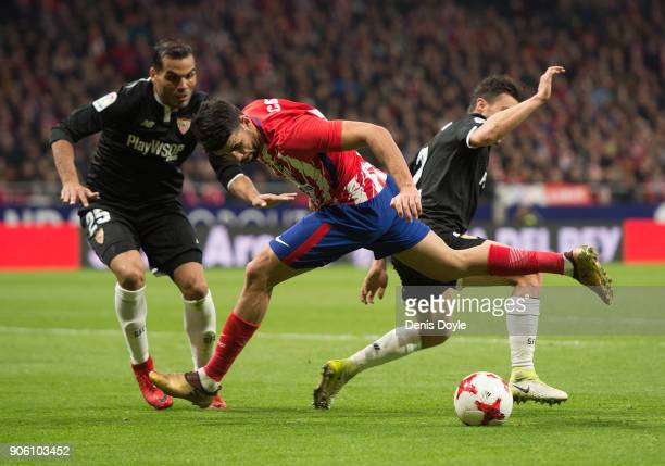 Diego Costa of Atletico Madrid in action against Sebastien Corchia and Gabriel Mercado of Sevilla during the Copa del Rey Quarter Final First Leg...
