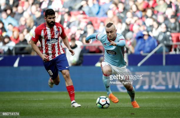 Diego Costa of Atletico Madrid in action against Stanislav Lobotka of Celta Vigo during the La Liga soccer match between Atletico Madrid and Celta...