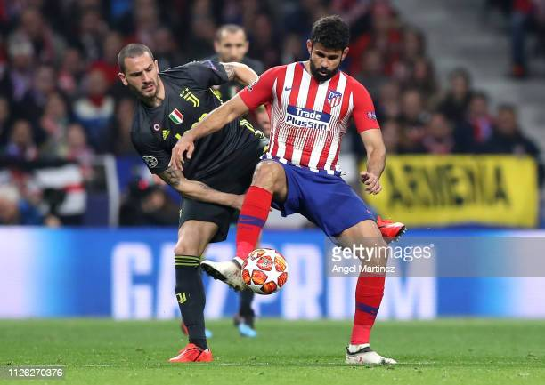 Diego Costa of Atletico Madrid is challenged by Leonardo Bonucci of Juventus during the UEFA Champions League Round of 16 First Leg match between...