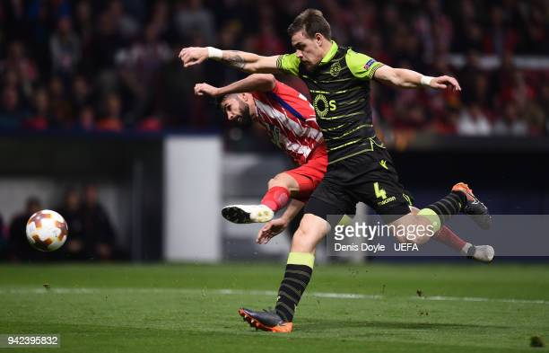 Diego Costa of Atletico Madrid is challenged by Sebastian Coates of Sporting CP during the UEFA Europa League quarter final leg one match between...