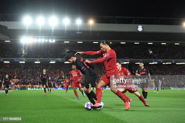 Diego Costa of Atletico Madrid is challenged by Virgil van Dijk of Liverpool during the UEFA Champions League round of 16 second leg match between...