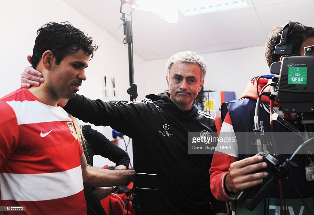 Diego Costa of Atletico Madrid is embraced by Jose Mourinho manager of Chelsea after the UEFA Champions League Semi Final first leg match between Club Atletico de Madrid and Chelsea at Vicente Calderon Stadium on April 22, 2014 in Madrid, Spain.