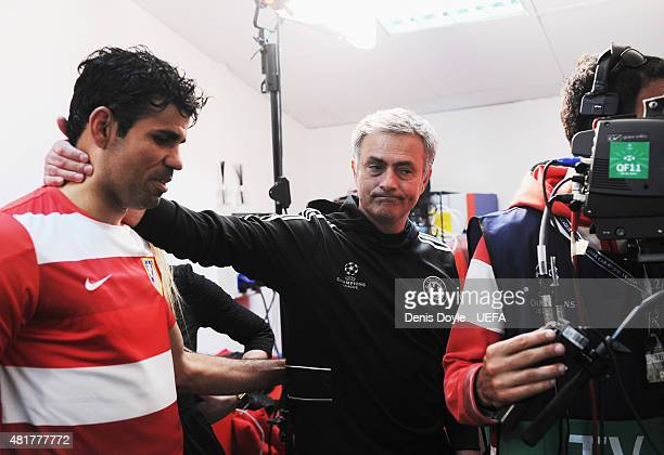 Diego Costa of Atletico Madrid is embraced by Jose Mourinho manager of Chelsea after the UEFA Champions League Semi Final first leg match between...