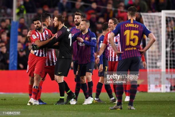 Diego Costa of Atletico Madrid is restrained by team mate Jan Oblak as he is sent off during the La Liga match between FC Barcelona and Club Atletico...