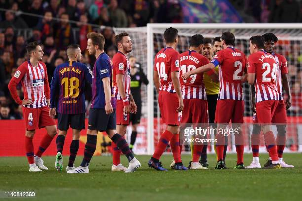 Diego Costa of Atletico Madrid is sent off by referee Jesus Gil Manzano during the La Liga match between FC Barcelona and Club Atletico de Madrid at...