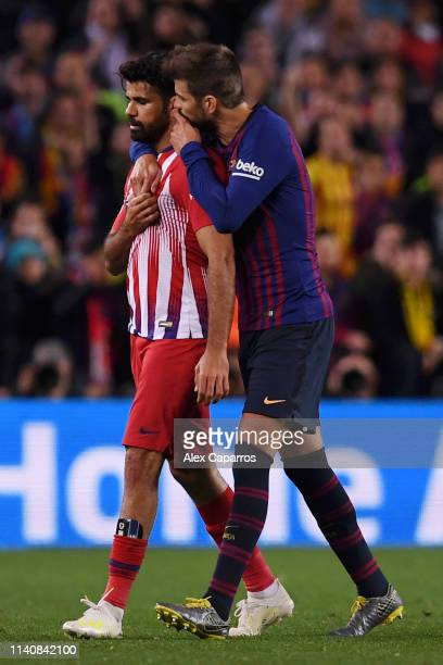 Diego Costa of Atletico Madrid is spoken to by Gerard Pique of Barcelona as he is sent off during the La Liga match between FC Barcelona and Club...