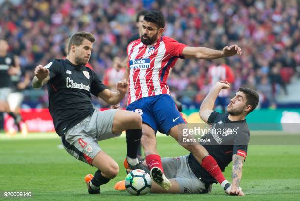 Diego Costa of Atletico Madrid is tackled by Inigo Martinez and Unai Nunez of Athletic Club during the La Liga match between Atletico Madrid and...
