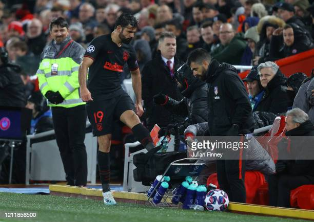 Diego Costa of Atletico Madrid kicks a bunch of water bottles as he reacts to being subbed during the UEFA Champions League round of 16 second leg...