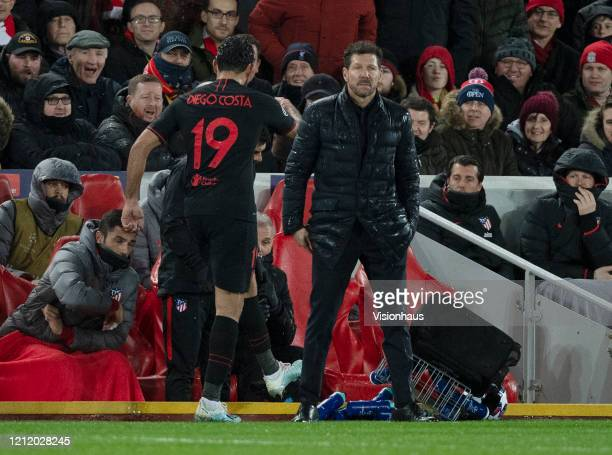 Diego Costa of Atletico Madrid kicks a crate of water bottles behind Atletico coach Diego Simeone after being substituted during the UEFA Champions...