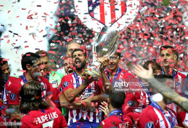 Diego Costa of Atletico Madrid lifts the trophy as Atletico Madrid celebrate victory following the UEFA Super Cup between Real Madrid and Atletico...