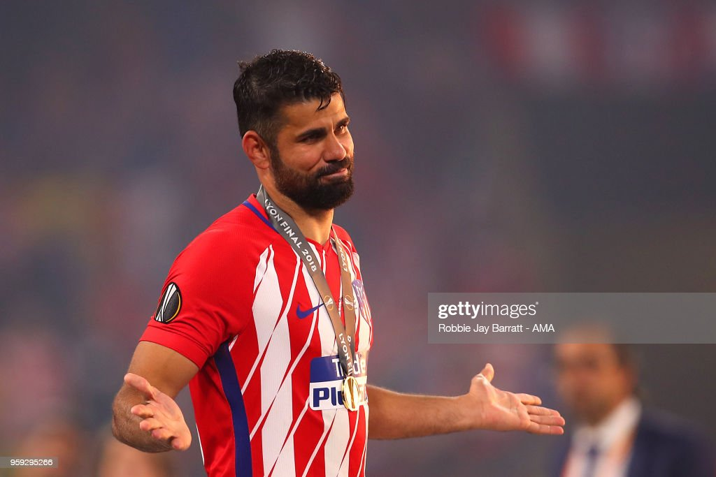 Diego Costa of Atletico Madrid reacts after receiving his winners medal at the end of the UEFA Europa League Final between Olympique de Marseille and Club Atletico de Madrid at Stade de Lyon on May 16, 2018 in Lyon, France.