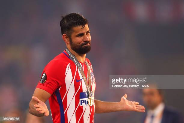 Diego Costa of Atletico Madrid reacts after receiving his winners medal at the end of the UEFA Europa League Final between Olympique de Marseille and...