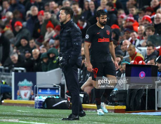 Diego Costa of Atletico Madrid reacts to being subbed as he walks past Diego Simeone Manager of Atletico Madrid during the UEFA Champions League...