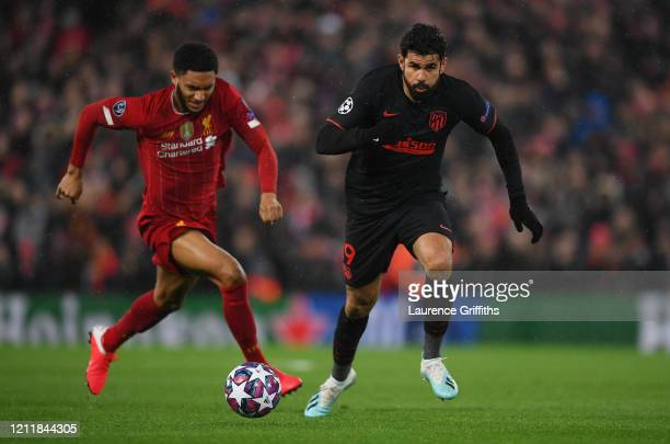 Diego Costa of Atletico Madrid runs with the ball away from Joe Gomez of Liverpool during the UEFA Champions League round of 16 second leg match...
