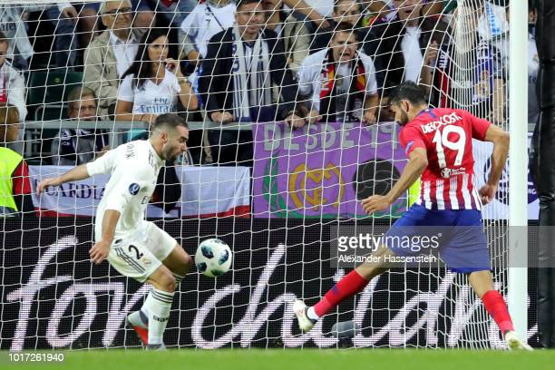 Diego Costa of Atletico Madrid scores his sides second goal during the UEFA Super Cup between Real Madrid and Atletico Madrid at Lillekula Stadium on...