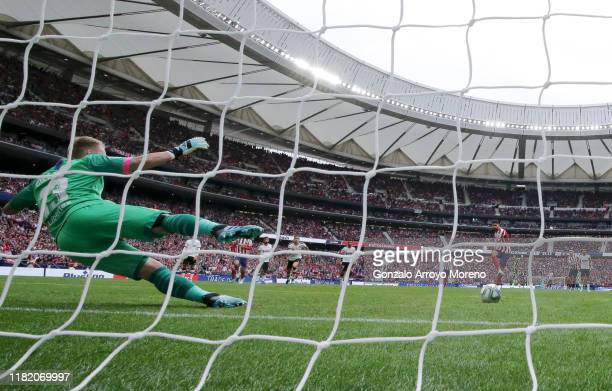 Diego Costa of Atletico Madrid scores his team's first goal from the penalty spot during the Liga match between Club Atletico de Madrid and Valencia...