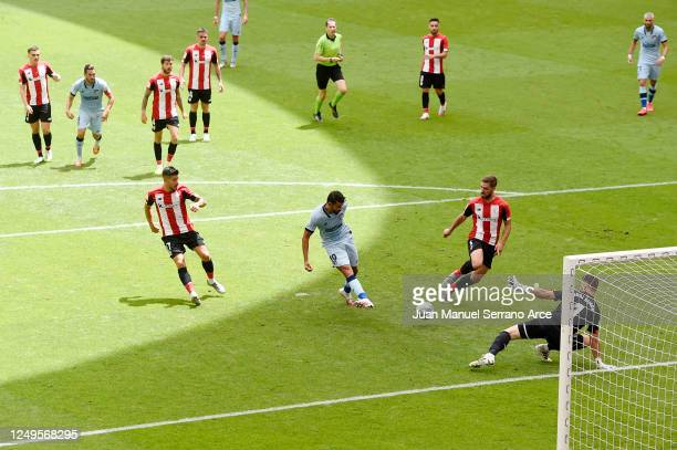 Diego Costa of Atletico Madrid scores his team's first goal past Unai Simon of Athletic Club during the Liga match between Athletic Club and Club...