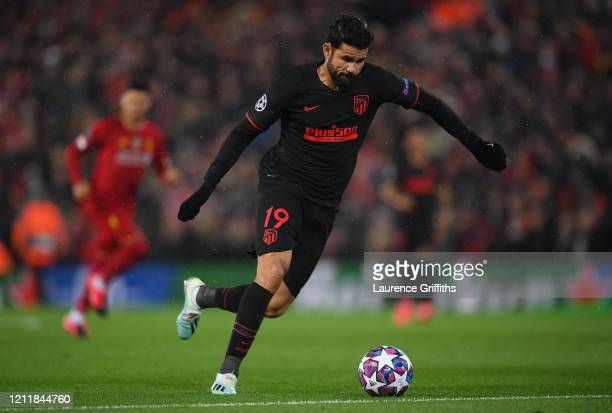 Diego Costa of Atletico Madrid shoots during the UEFA Champions League round of 16 second leg match between Liverpool FC and Atletico Madrid at...